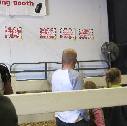 children at the milking booth